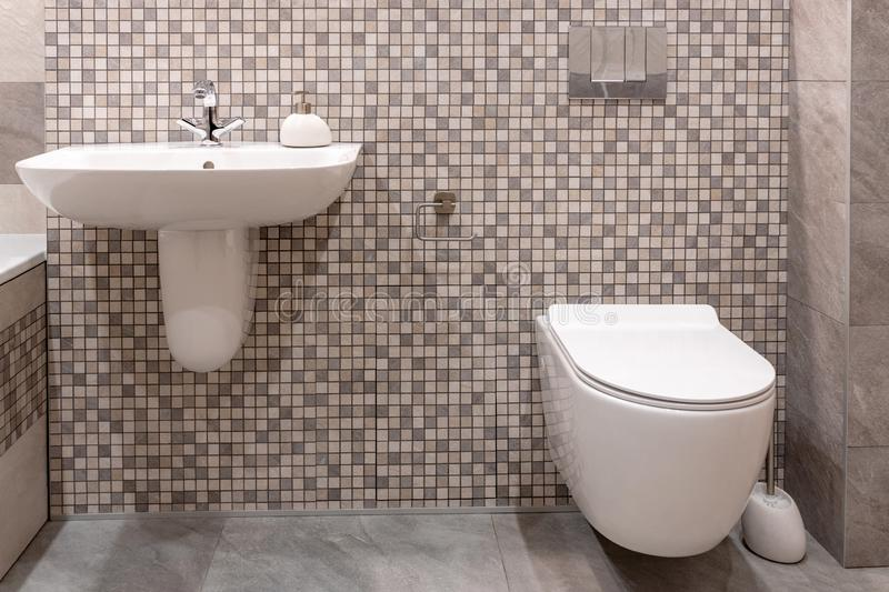 Sink and built-in toilet in modern bathroom. royalty free stock photography