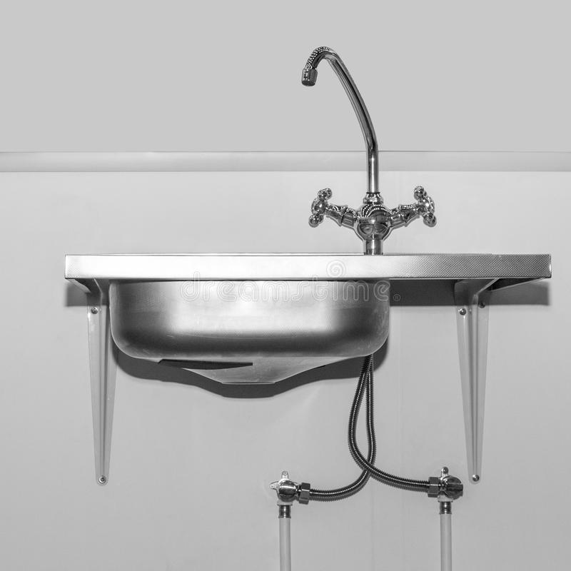 Kitchen sink with faucet for washing dishes stock image