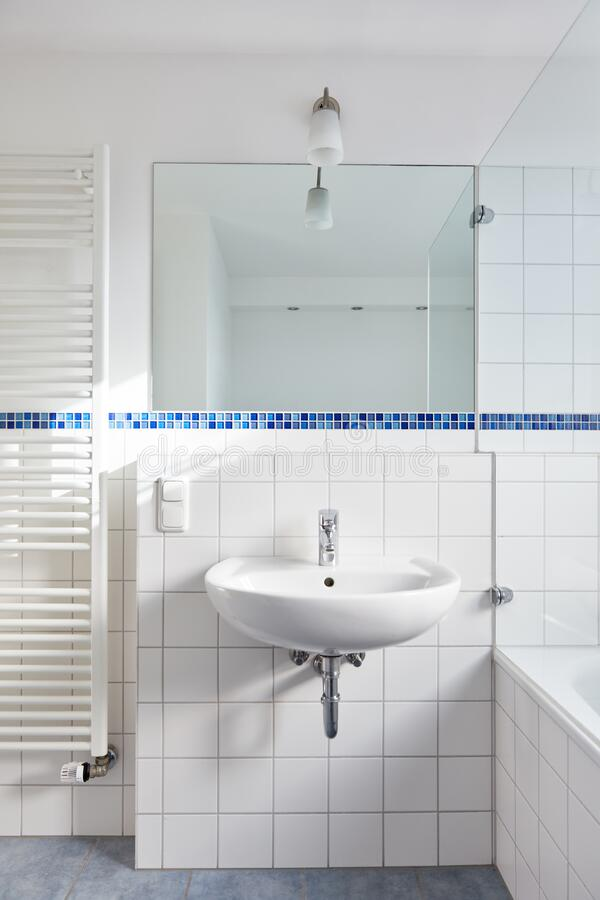 Free Sink With Mirror In The Bathroom Next To Tubular Radiators Stock Images - 194122384