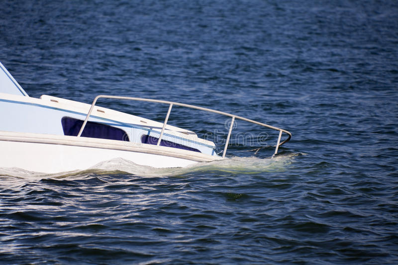 Sinking. Pleasure boat in the blue ocean royalty free stock photos