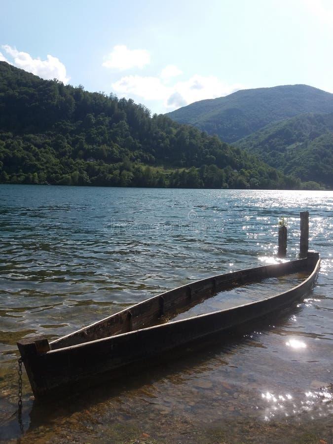 Sinking boat in water lake royalty free stock image