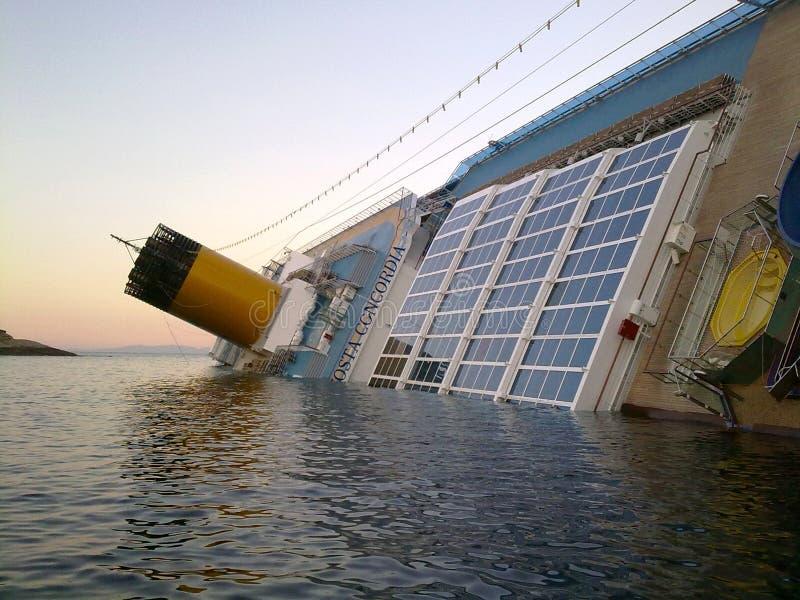 Sinking cruise ship Costa Concordia royalty free stock image