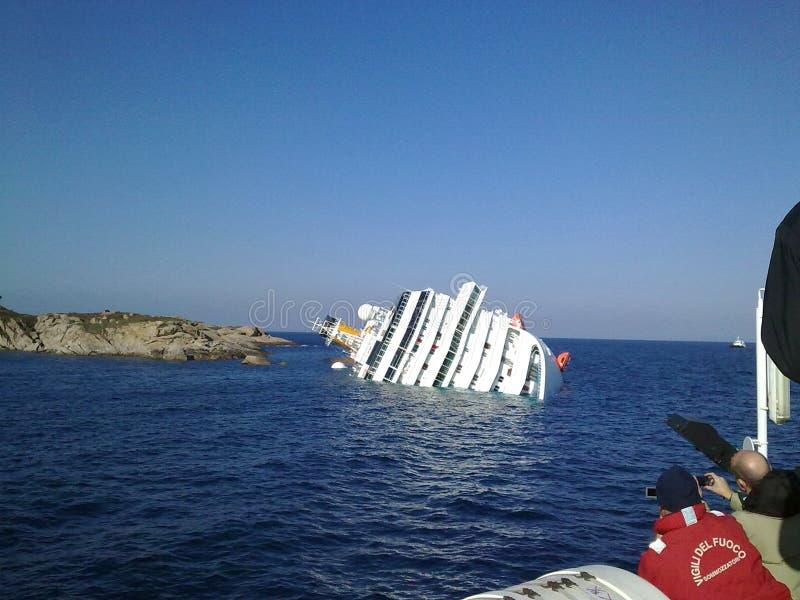 Sinking cruise ship Costa Concordia stock photography