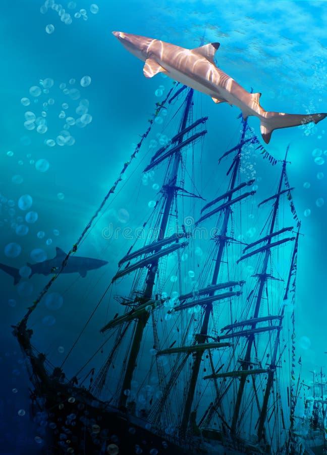 Sinking ship on sea bottom and sharks stock photography