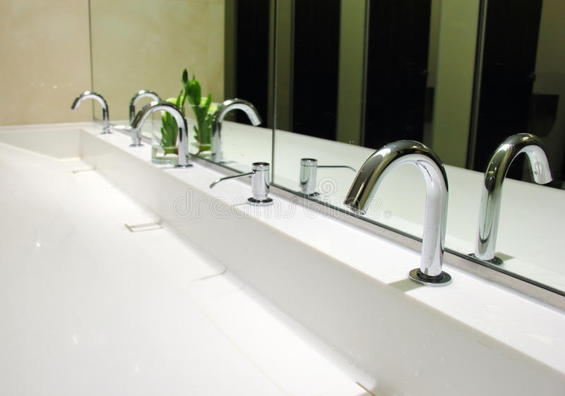Sinks and taps in toilet royalty free stock photos