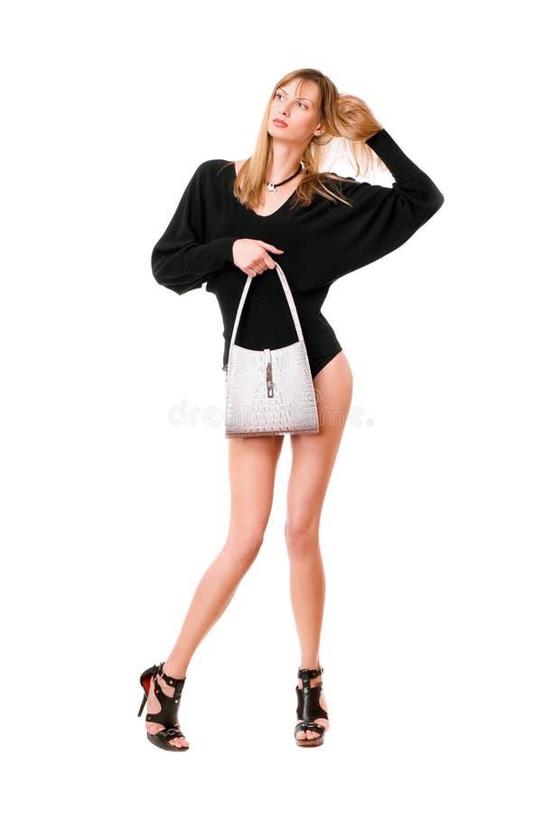 Sinnlig dam med den vita handväskan royaltyfri foto
