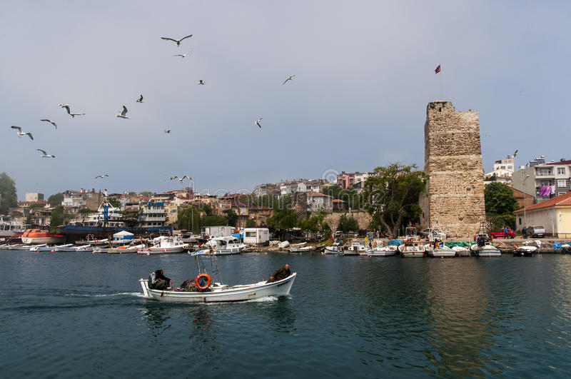 Sinop city in Turkey. Waterfront of Sinop city on the isthmus of Ince Burun viewed from the sea with a fishing boat in the foreground, Turkey stock photo