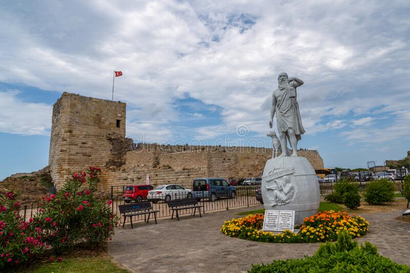 Sinop/Turkey - August 04 2019: Statue Of Diogenes, famous ancient Greek philosopher born in Sinop in the 5th century BC. Sinop. Fortress in background royalty free stock images