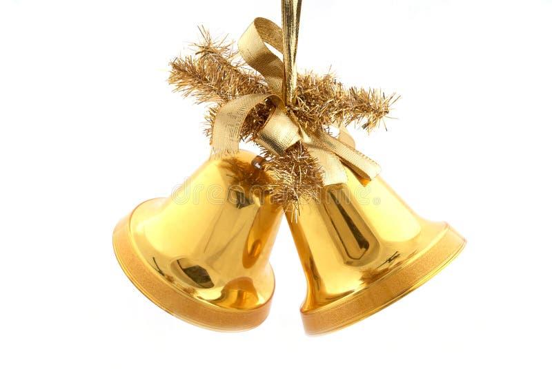 Sinos de Natal do ouro imagens de stock royalty free