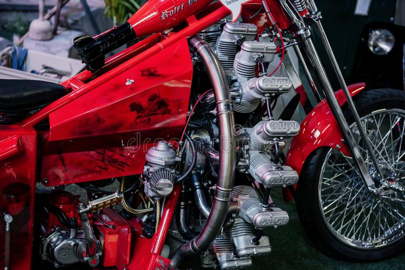SINSHEIM, GERMANY - OCTOBER 16, 2018: Technik Museum. Right part of the original rare motorcycle with artwork on it stock image