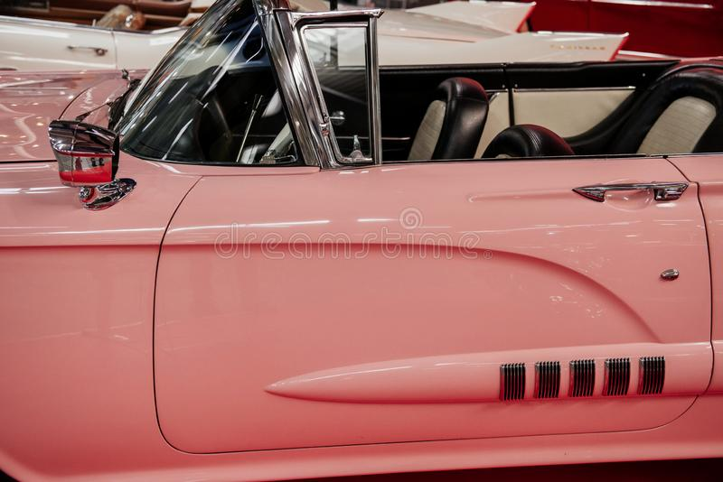 SINSHEIM, GERMANY - OCTOBER 16, 2018: Technik Museum. Side view of the rare pink cabriolet. Beautiful classic stock photo