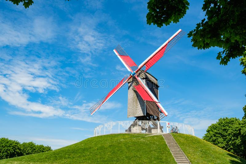 Sint-Janshuis Mill, windmill with few cloud and blue sky background in Brugge, Belgium. stock photography