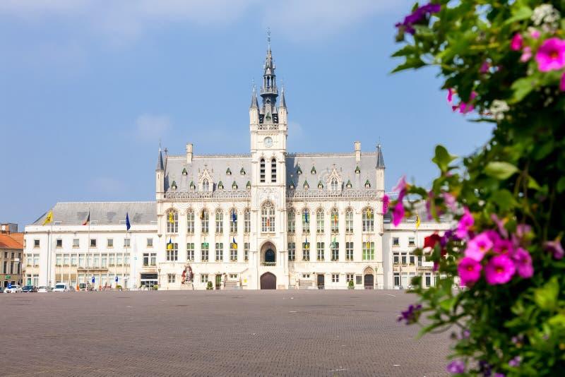 Sint Niklaas town hall, Belgium. The market square and town hall of the Flemish town of Sint Niklaas in Belgium behind some flowers stock photo