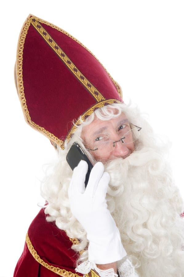 Sinterklaas avec un téléphone portable image libre de droits