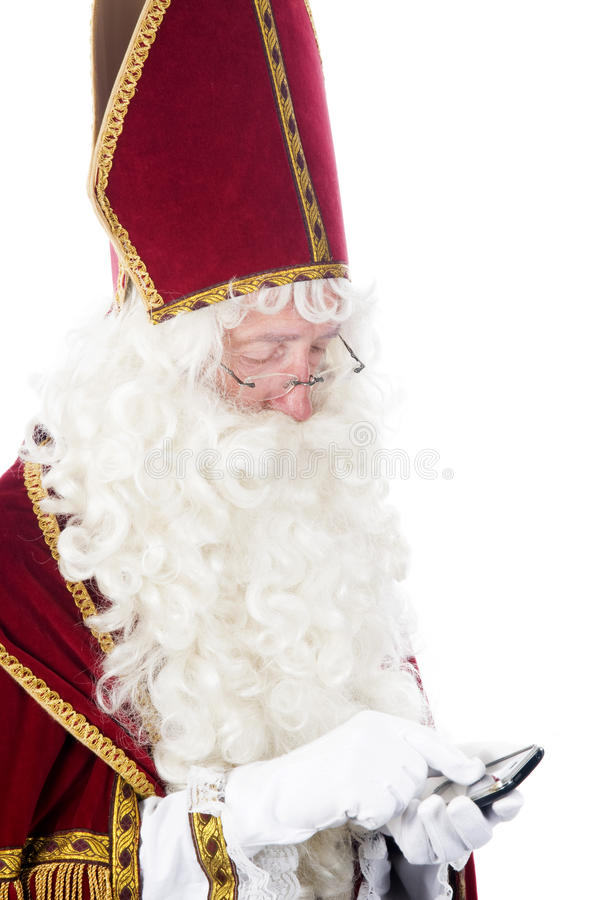 Sinterklaas avec un téléphone portable images libres de droits