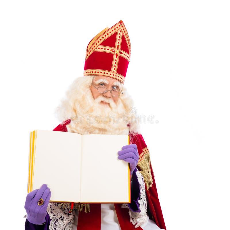 Sinterklaas con el libro en el fondo blanco fotos de archivo
