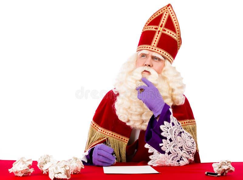 Sinterklaas, i att tänka, poserar royaltyfria foton