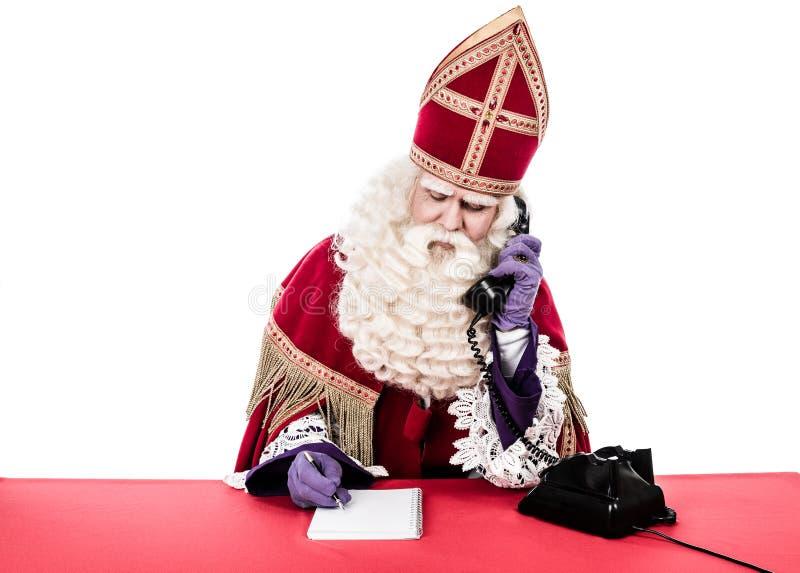 Sinterklaas mit altem Weinlesetelefon stockbild