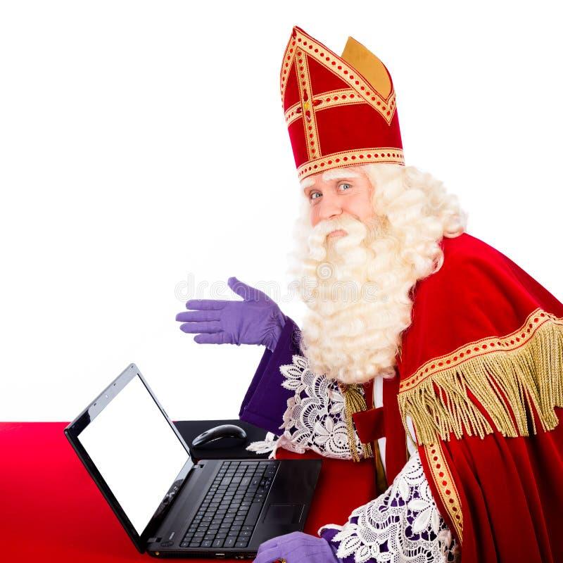 Sinterklaas mit Notizbuch oder Laptop stockfotos