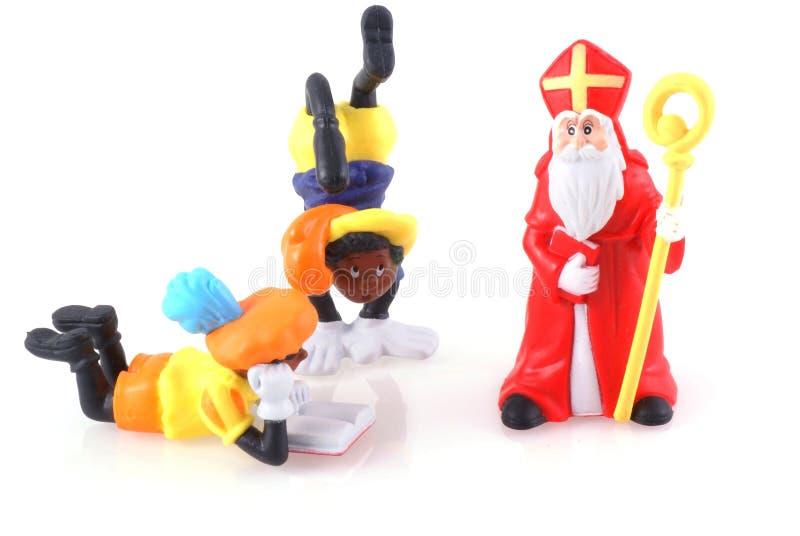 Sinterklaas y algo pieten. foto de archivo