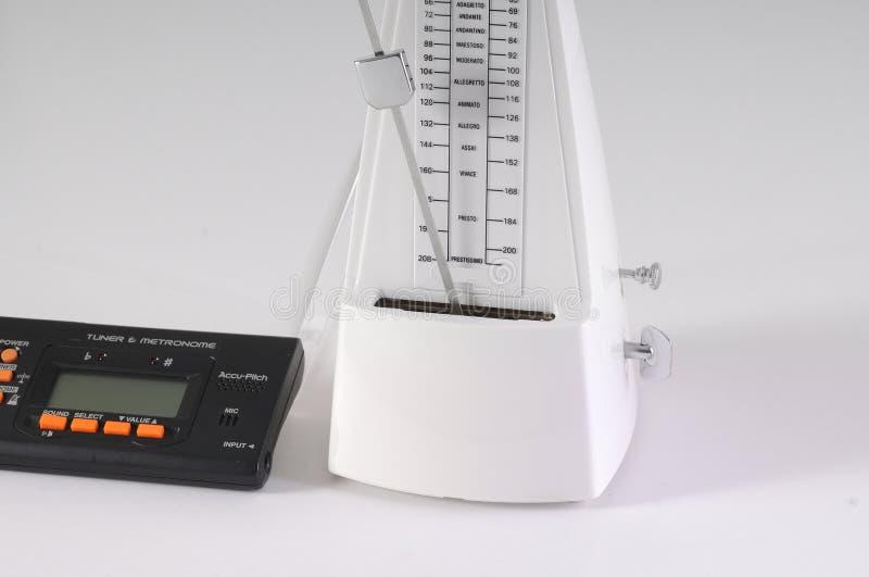 Sintonizzatore e metronomo meccanico fotografia stock libera da diritti