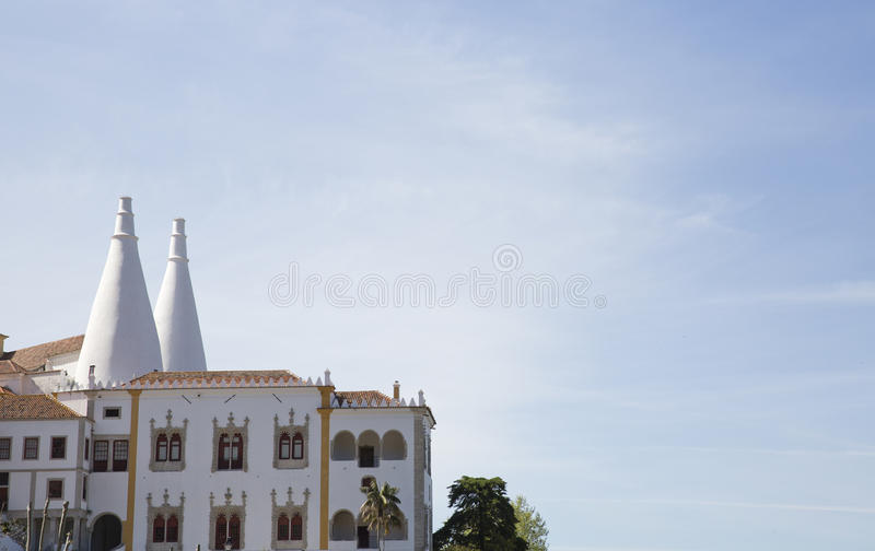 Sintra National Palace Palacio Nacional de Sintra also called Town Palace with distinct chimneys on a typical misty day royalty free stock photo