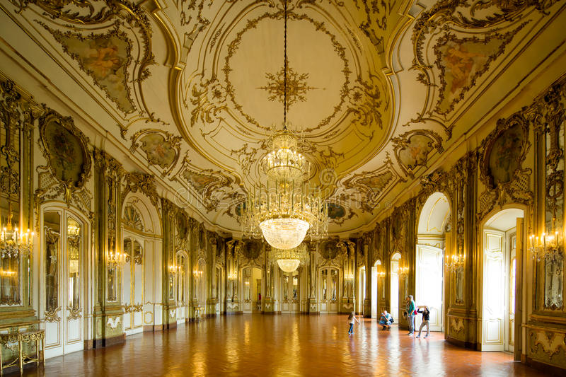 Sintra National Palace. SINTRA, PORTUGAL - JULY 6: Symmetrical composition of rich decorated rooms in the Queluz National Palace , on July 6, 2014 in Sintra royalty free stock photo
