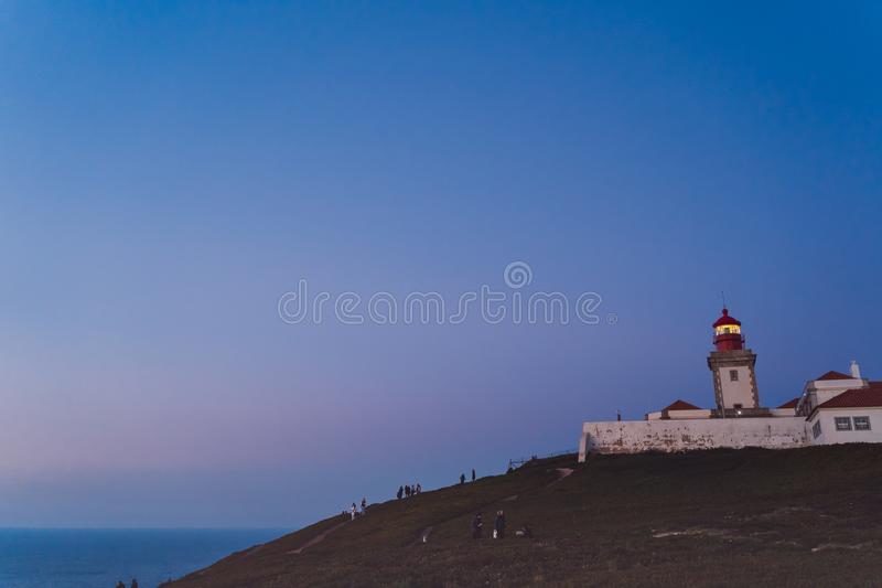 Sintra, Portugal - 01/05/19: Cape Roca lighthouse Cabo da Roca. Blue night sky and atlantic ocean, Westernmost Europe royalty free stock photo
