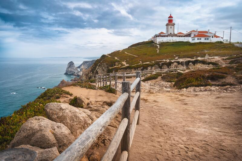 Sintra Portugal. Cape Roca and red lighthouse. Cabo da Roca. Travel and tourism landmark with beautiful coastline cliffs. Of atlantic ocean royalty free stock photo
