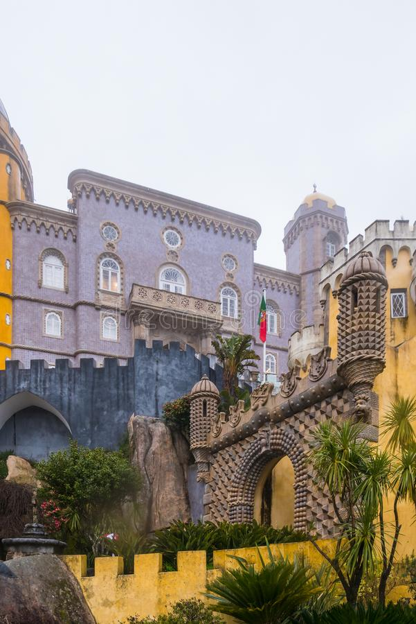 Colored Palace. Sintra, Portugal - March 7, 2019 : View of Pena Palace`s entrance and color contrast of the different parts of the building at Sintra, Portugal royalty free stock images