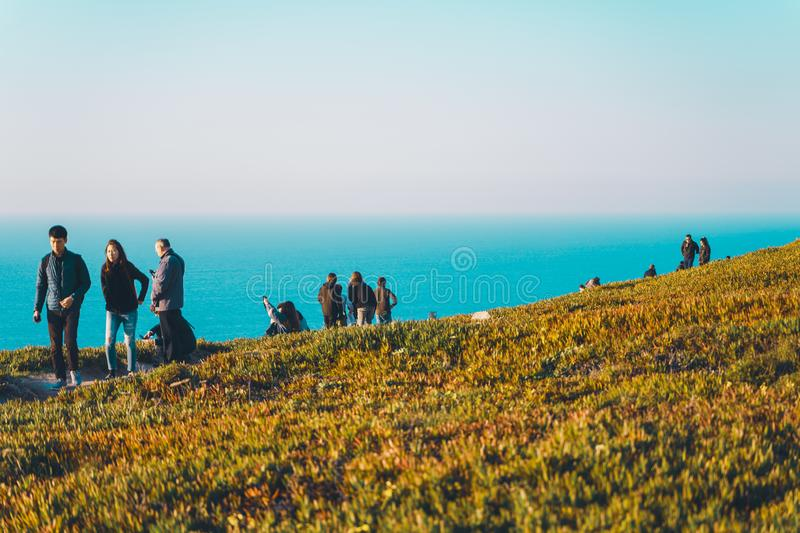 Sintra, Portugal - 01/05/19: People at the edge of europe at sunset, Cape Roca royalty free stock image