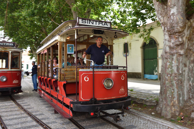 Sintra street scene with old red trams stock photography