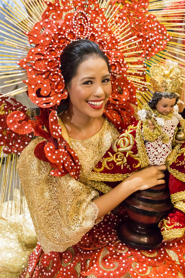 Sinulog dancer. Holding `santo niño`. Sinulog is an important cultural and religious festival held annually in Cebu City in January to honor `santo niño