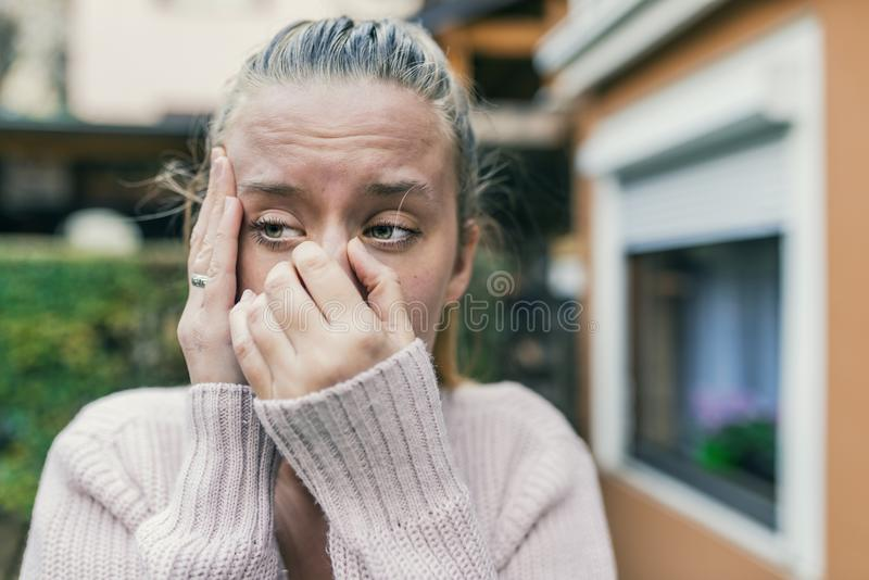 Sinus ache causing very paintful headache. Unhealthy woman in pa royalty free stock images