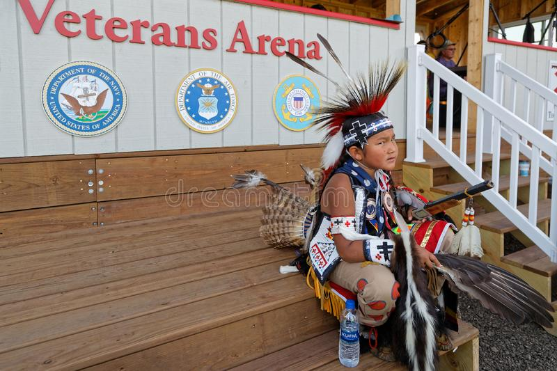 Sioux boy waits at the 49th annual United Tribes Pow Wow,. BISMARK, NORTH DAKOTA, September 8, 2018 : Sioux children at the 49th annual United Tribes Pow Wow stock photos