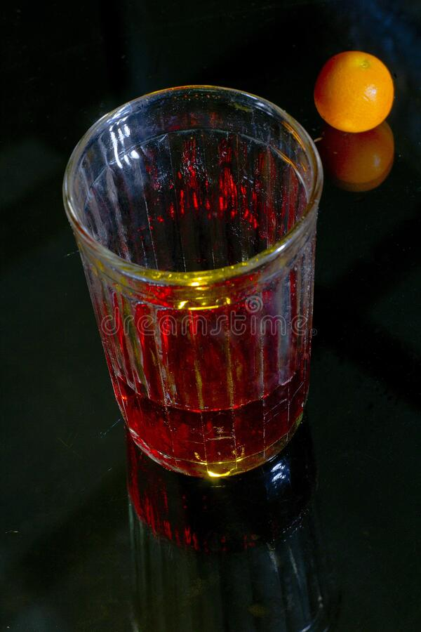 A SIP of wine. Thirst. Wine in a cut glass. royalty free stock image