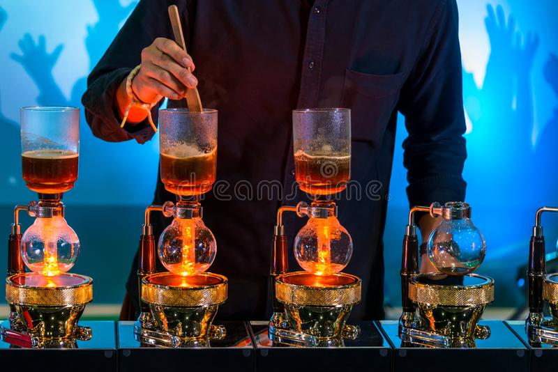 Siphon cacuum coffee maker grinder with drip brewing filtered coffee preparing in coffee shop stock photos