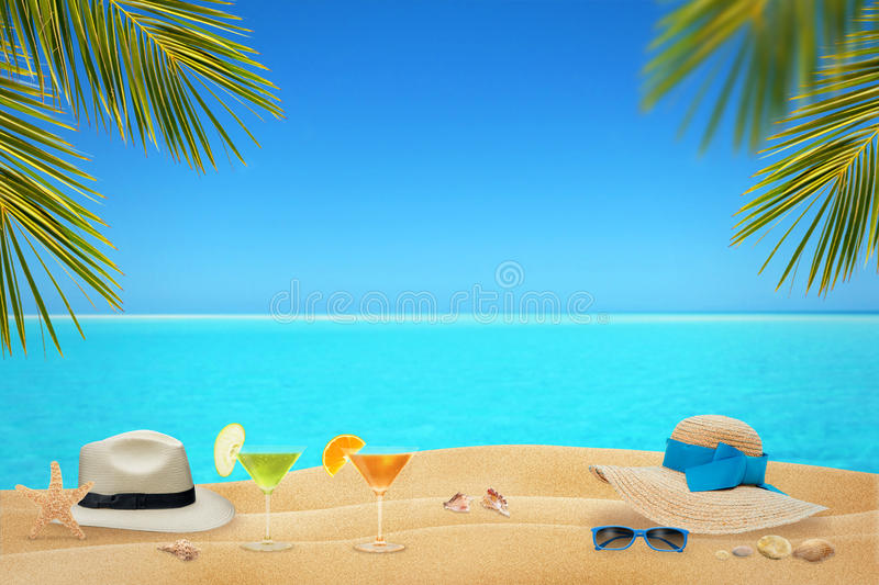 Sipping cocktails under the palm trees on the beach in hot summer days stock image