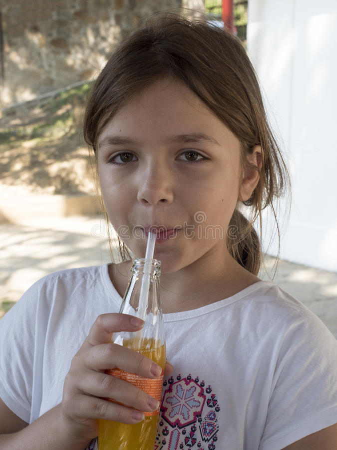 Sipping juice royalty free stock photography
