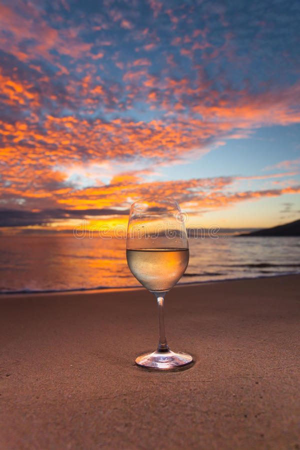 Sipping on wine on the Kihei shoreline royalty free stock photo
