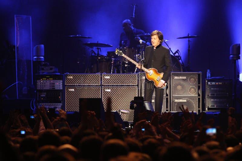 Sir Paul McCartney performs onstage at Olimpiyskiy stock photos