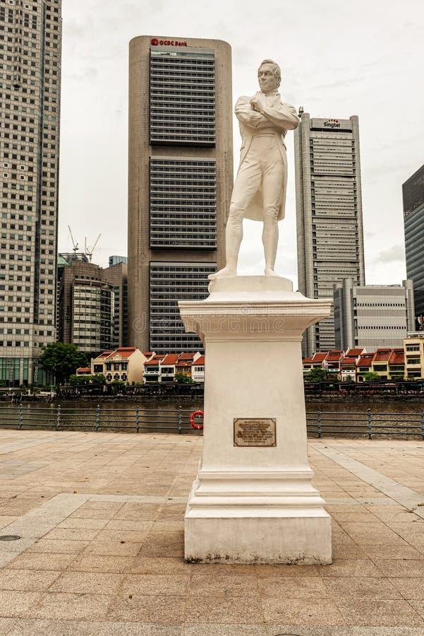 Sir Thomas Raffles statue at Ruffle`s landing site in Singapore. Singapore - January 14, 2018: Sir Thomas Raffles statue at Ruffle`s landing site. Plaza and royalty free stock images