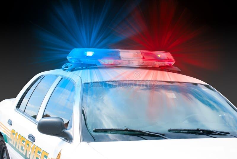 Sirenes & luzes de w do carro da aplicação da lei do xerife sobre imagens de stock