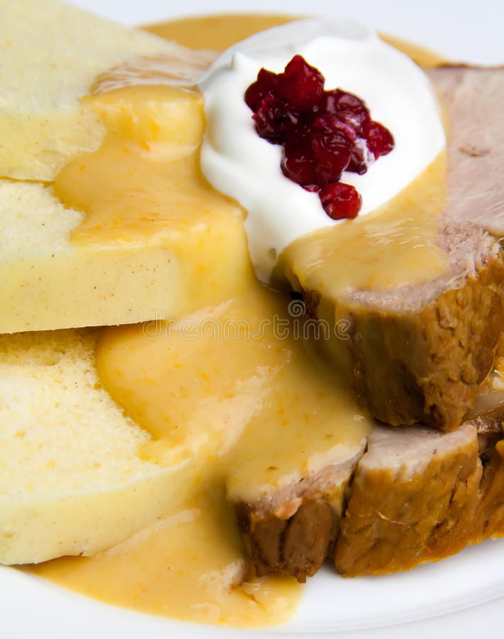 Sirloin in cream sauce. With dumplings and cranberries and whipped cream royalty free stock images