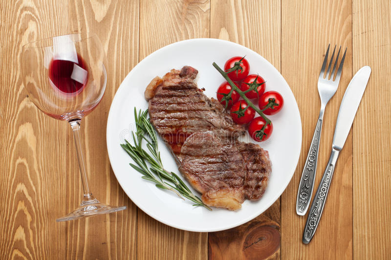 Sirloin steak with rosemary and cherry tomatoes on a plate royalty free stock photo