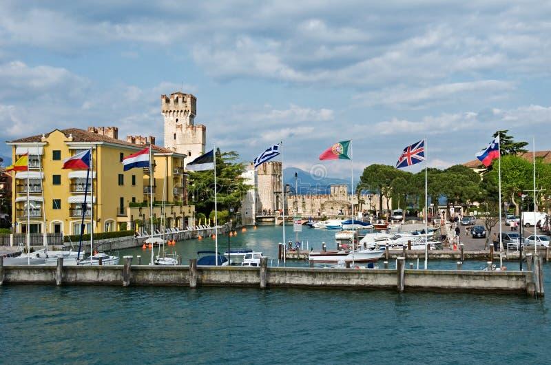 Sirmione, Garda lake. Flags at Sirmione, Garda lake, Italy royalty free stock images