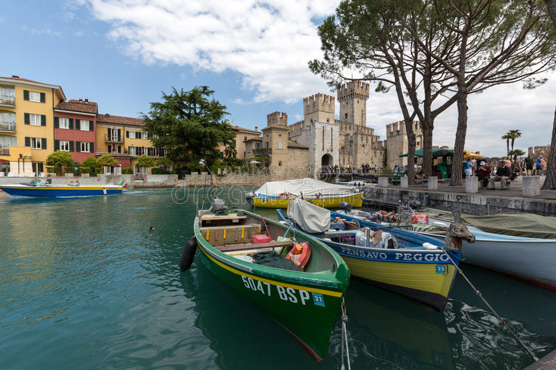 Sirmione - Italian small city on Garda lake with boats and castle.  stock image