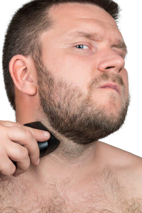 Sirva afeitar con la maquinilla de afeitar eléctrica fotografía de archivo