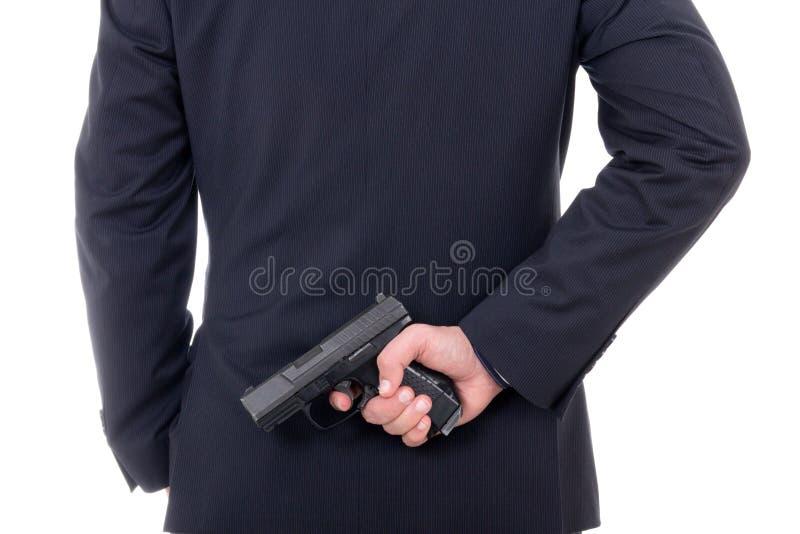 Sirva el arma de ocultación detrás el suyo detrás aislado en blanco foto de archivo libre de regalías