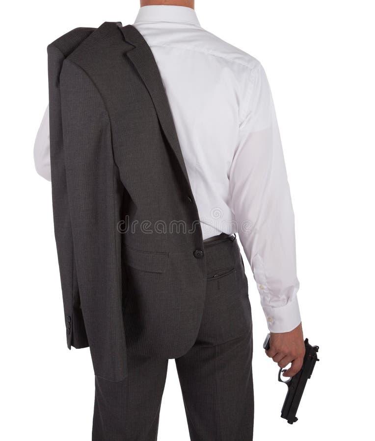 Sirva en un traje que sostiene un arma foto de archivo